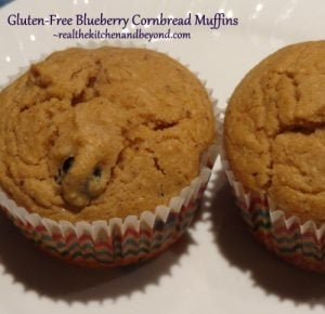 These Gluten Free Blueberry COrnbread Muffins are perfect for breakfast or two pair with soup. Eat immediately or bake and freeze for easy meals