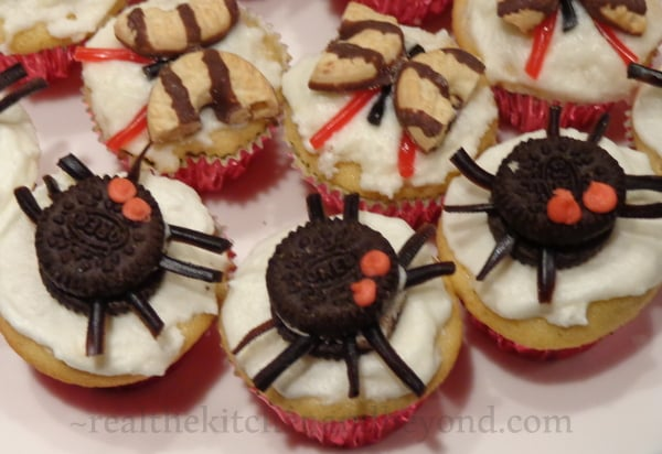 Strawberry lemonade cupcakes topped with butterflies and spiders for a preschool party