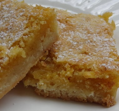 These lemon lime bars are a perfect crowd pleaser with their sweet tart lemon lime topping and melt in your mouth buttery crust