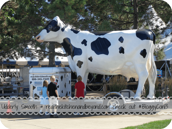Checking out the Udderly Smooth cow at #BloggyCon13