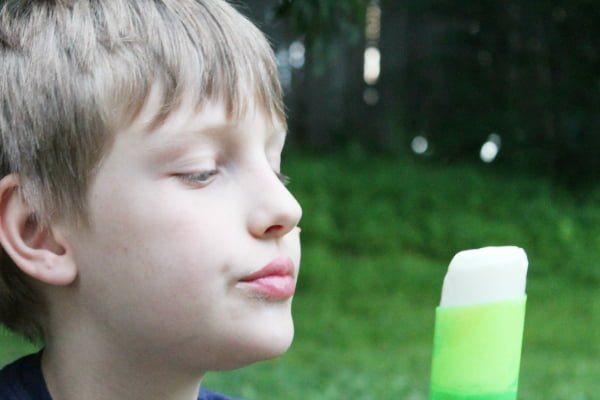 kid looking at key lime popsicle