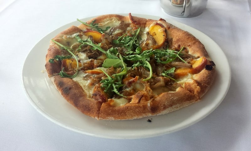 Emeril's Orlando Wood-Oven Pizza with Duck, Grilled Peaches, and Brie