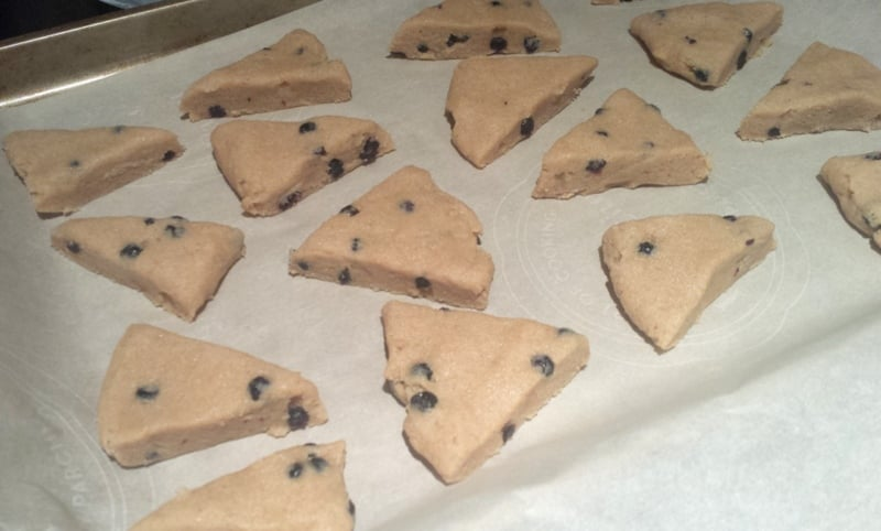 Whole Wheat Blueberry Scones sliced on tray