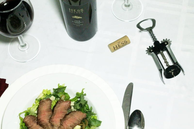 Flank Steak Salad with Caramelized Onions and Cheddar and Hess Collection Wine