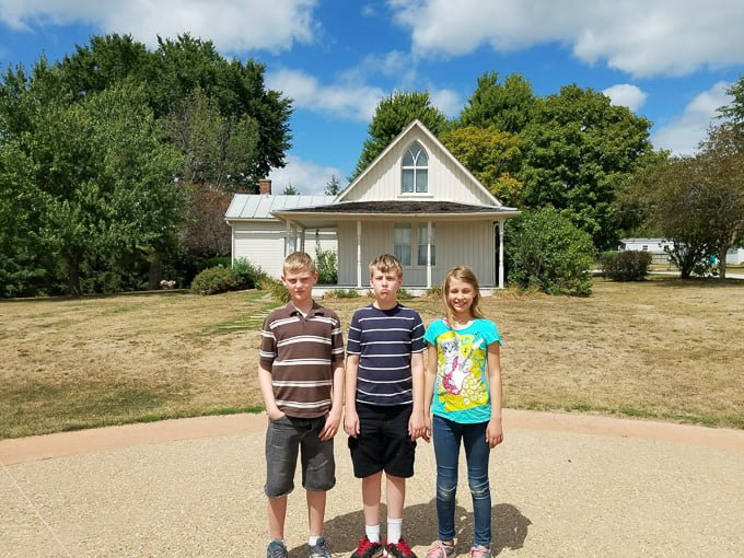 American Gothic House Kids in front of