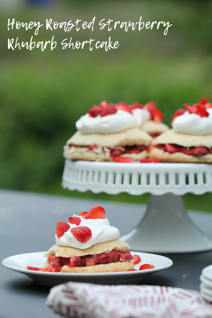 Strawberries are in season and I'm always looking fro good strawberry recipes (and rhubarb recipes) This honey roasted strawberry rhubarb shortcake is a twist on classic strawberry shortcake that you are sure to love. The perfect dessert for a summer party.